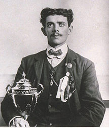 Dorando Pietri with his gilded silver cup given as compensation for missing the gold medal