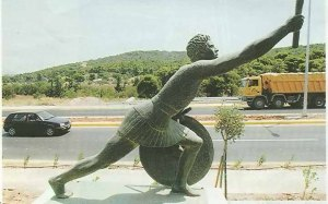 Statue of Pheidippides alongside the Marathon Road